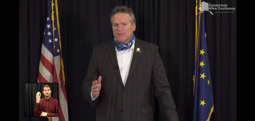 Alaska Gov. Mike Dunleavy appeals to Alaskans to support neighbors, businesses and charities affected by COVID-19 this holiday season. He made the appeal during a news conference, Dec. 15, 2020. A sign language interpreter is on the lower left. (Screen capture of news conference)