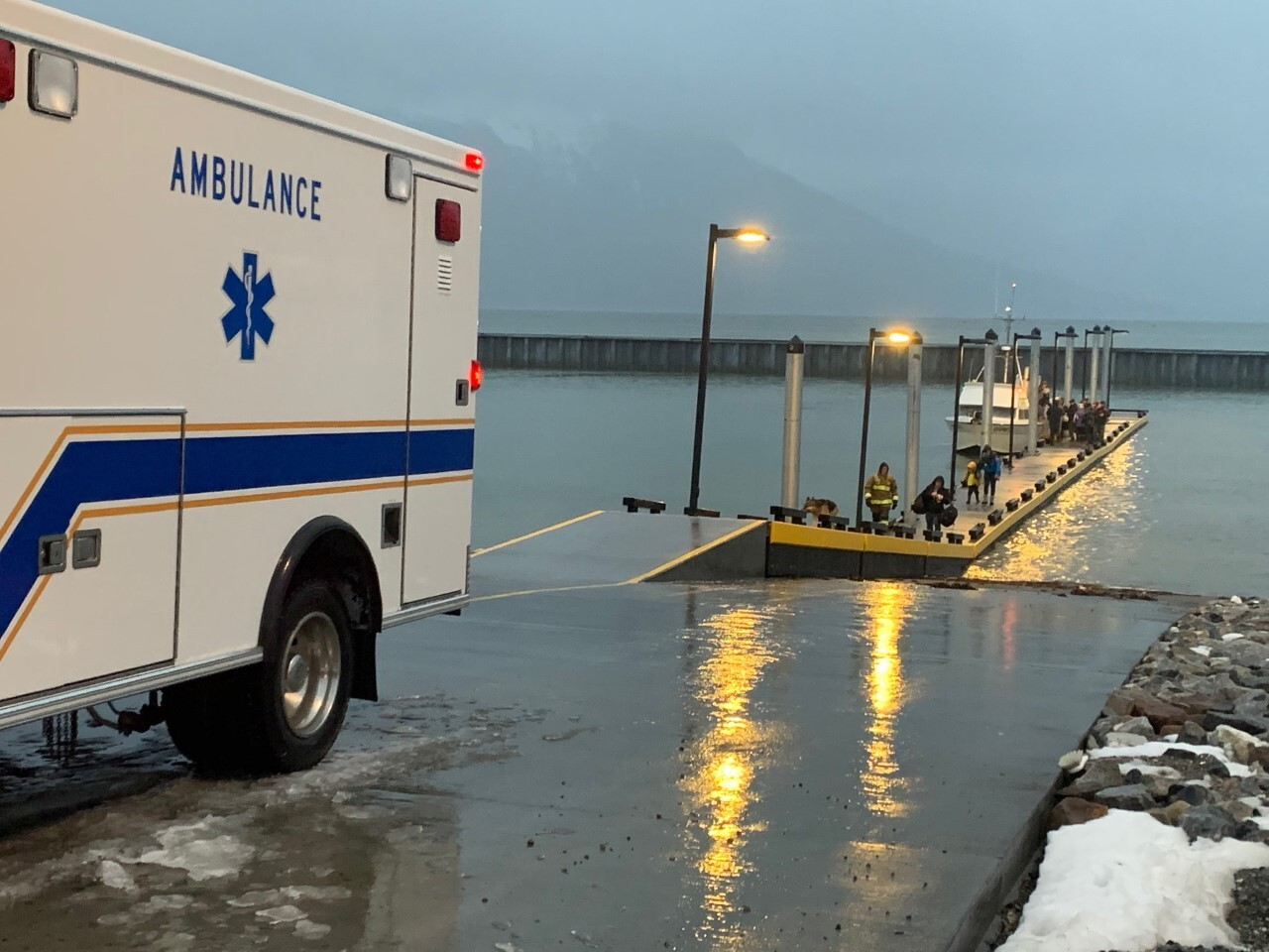 Haines evacuees get off rescue boats at the city's harbor.