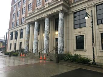 The entrance to Alaska's Capitol in Juneau on Sunday, Jan. 17, 2021. Four safety cones are at the bottom of the stairs.