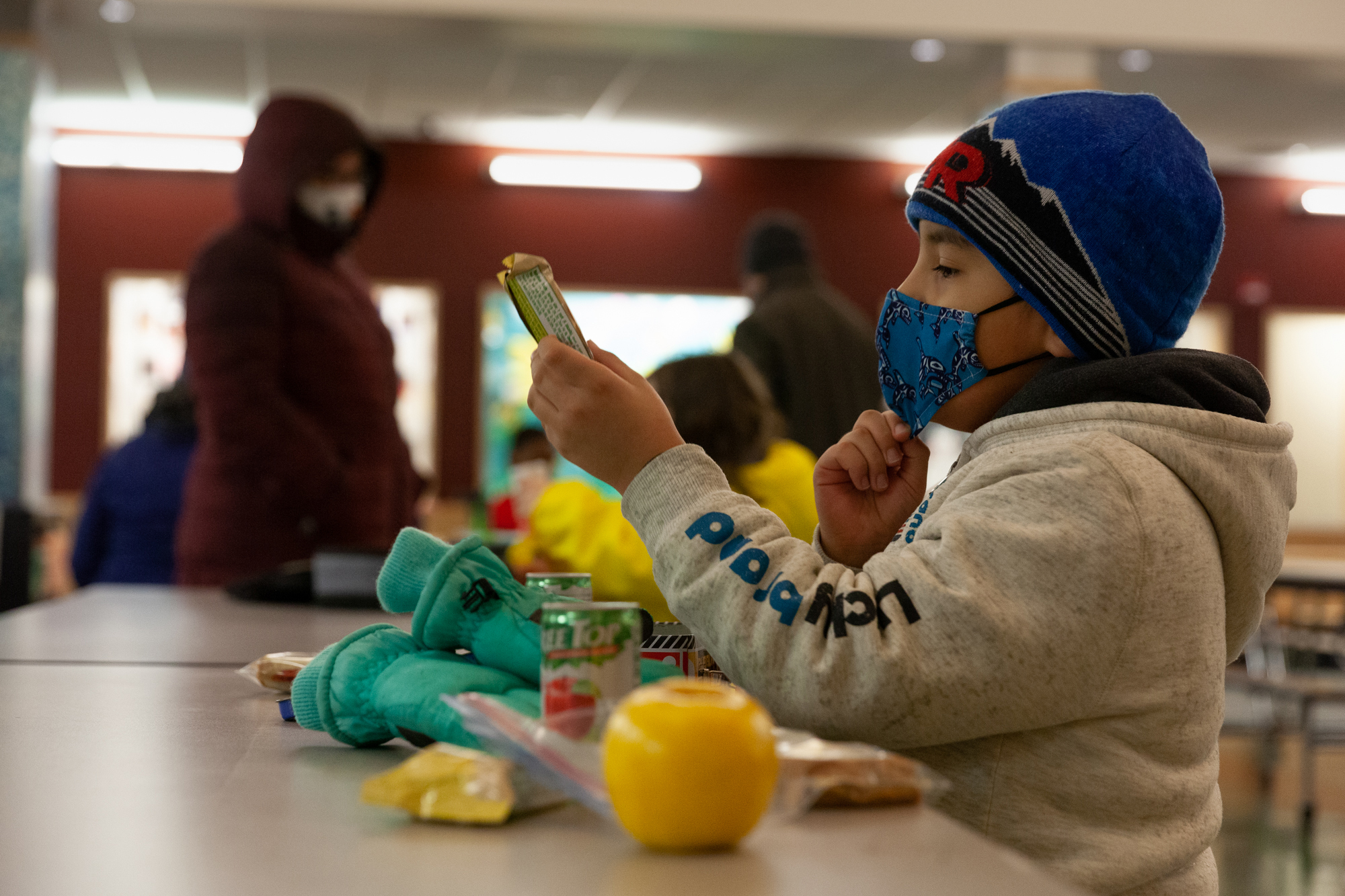 Tanner Cooper eyes his lunch at Sayéik Gastineau Community School where he and his sister returned for in-person learning on Thursday, Jan. 14, 2021, in Juneau, Alaska. (Photo by Rashah McChesney/KTOO)