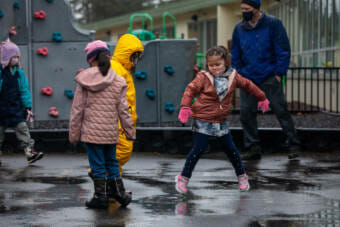 Avery Barnaby dances on the playground during her first day back to school as a first-grader at Sayéik Gastineau Community School on Thursday, Jan. 14, 2021, in Juneau, Alaska. (Photo by Rashah McChesney/KTOO)