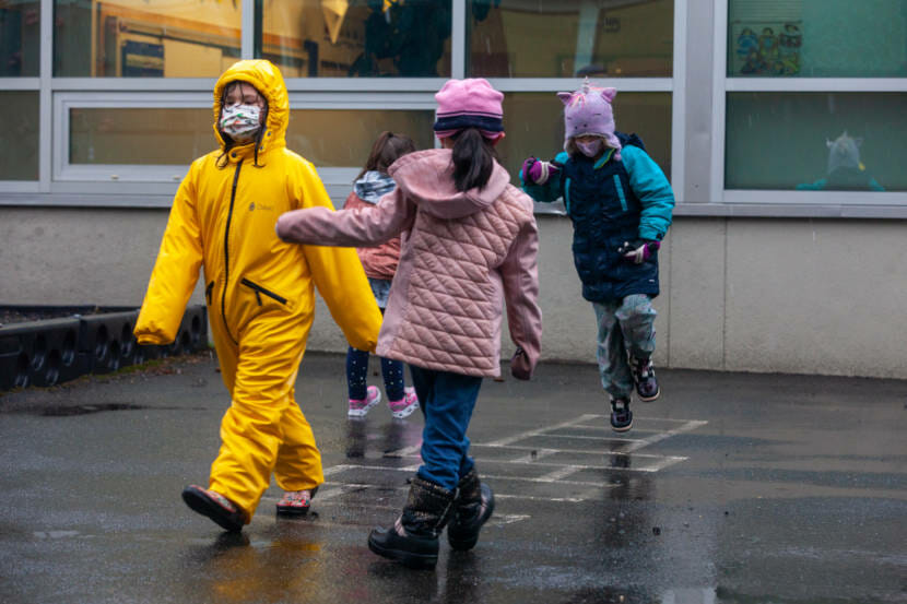A group of first grade students play on the playground at Sayéik Gastineau Community School on Thursday, Jan. 14, 2021, in Juneau, Alaska. The school resumed in-person classes after spending months doing remote learning because of the COVID-19 pandemic. (Photo by Rashah McChesney/KTOO)