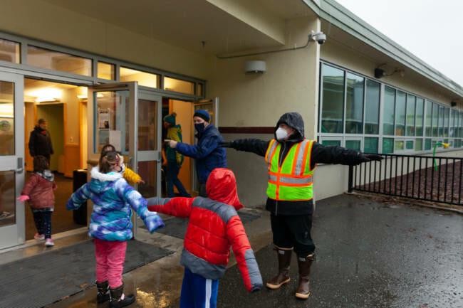 Students at Sayéik Gastineau Community School spread their arms apart to keep socially distanced while standing in line on Thursday, Jan. 14, 2021, in Juneau, Alaska. (Photo by Rashah McChesney/KTOO)