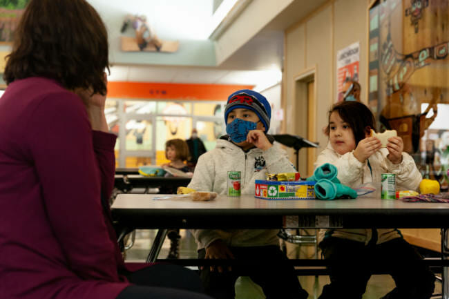 Tanner and Amnara Cooper meet the new principal of Sayéik Gastineau Community School during their first day of in-person classes on Thursday, Jan. 14, 2021, in Juneau, Alaska. (Photo by Rashah McChesney/KTOO)