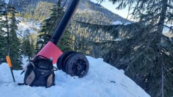 Backpack wheels by damaged Ptarmigan chairlift pole on Insane