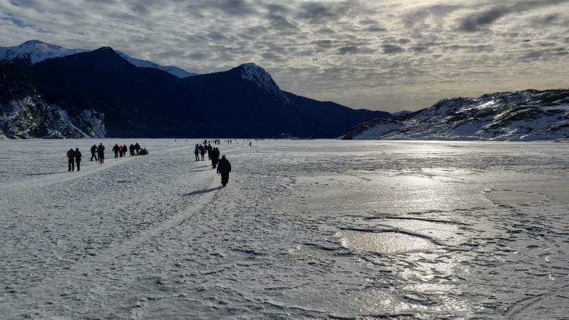 Hikers crossing frozen Mendenhall Lake