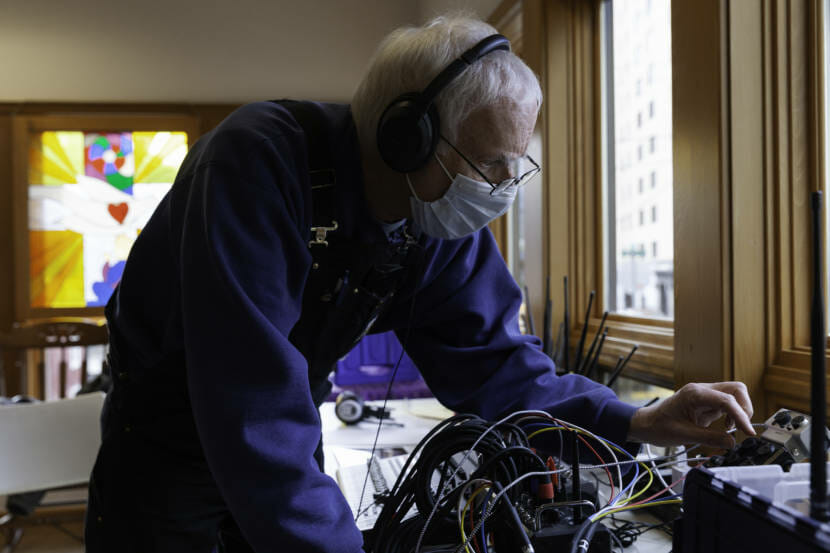 Tom Fullam monitors the audio coming in from dozens of cars and at least 30 microphones during a Choir from Cars meeting on Saturday, March 6, 2021 in Juneau, Alaska. (Photo by Rashah McChesney/KTOO)