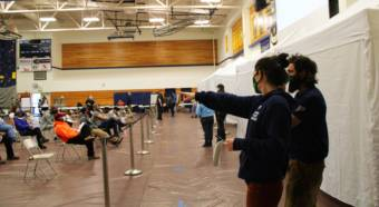 Despite difficulties with getting access to COVID-19 vaccines earlier in the year, roughly 1,800 people in Unalaska were vaccinated at a mass vaccination clinic on Thursday. (Maggie Nelson/KUCB)