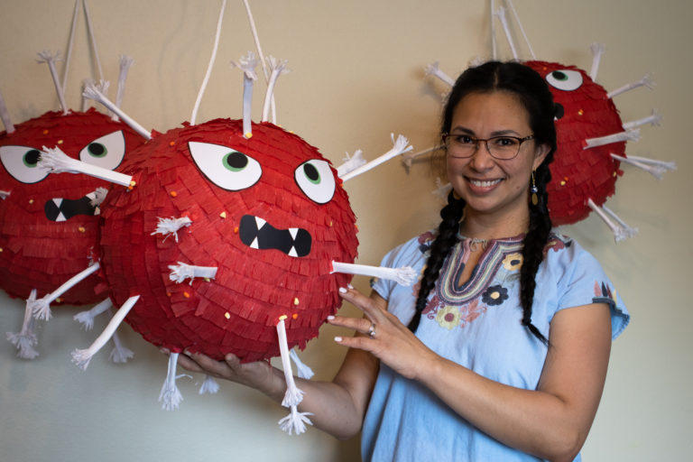 This Anchorage piñata maker is crafting giant COVID germs for smashing