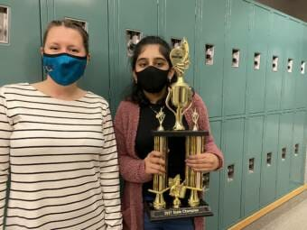 Spelling bee champion, Ishita Khiani (right) poses with her trophy at Dzantik'i Heeni Middle School on Thursday, April 29, 2021. Electra Gardinier (left) is a spelling bee proctor and teacher at DHMS.