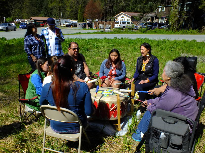 Spirit Lodge Singers use a healing drum to offer songs and prayer for the safety of Geraldine Nelson as the search for her continues around Lemon Creek on Wednesday, May 19, 2021, in Juneau, Alaska. (Photo by Matt Miller/KTOO).