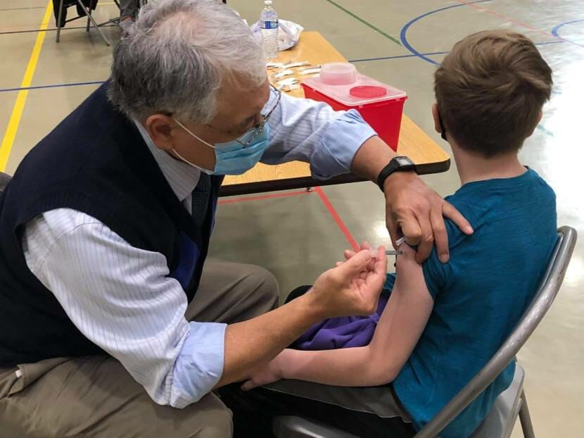 12-year-old Garrett McGuan gets his first dose of the COVID1-9 vaccine at Dzantik'i Heeni Middle School on Monday, May 17.