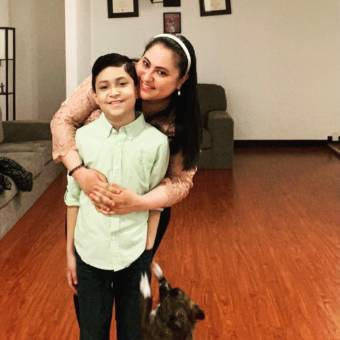 Ivette Perez hugs her 10-year-old son, Ivan.