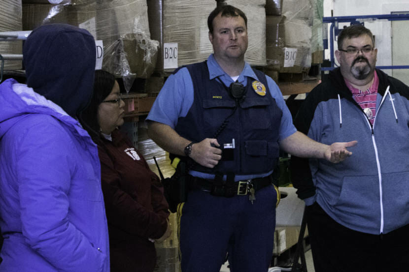 """Alaska State Trooper Josh Bentz talks to people who showed up to search for Geraldine """"Gerry"""" Nelson on May 5, 2021, at Sacred Shine in Juneau, Alaska. It has been six days since Nelson went missing from her Lemon Creek home. (Photo by Lyndsey Brollini/KTOO)"""