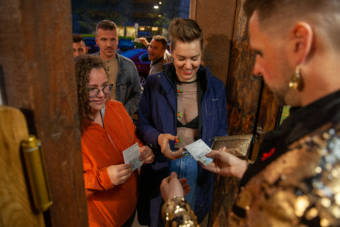 Abi Spofford shows her COVID-19 vaccination card to get into a live drag show on Saturday, May 22, 2021, in Juneau, Alaska. (Photo by Rashah McChesney/KTOO)