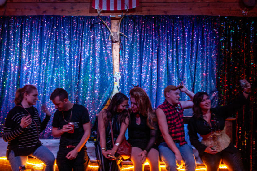 Audience members and performers gather after a drag show on Saturday, May 22, 2021, at the Red Dog Saloon in Juneau, Alaska. (Photo by Rashah McChesney/KTOO)