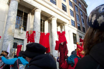Women carry red dresses to raise awareness for Missing and Murdered Indigenous People during the Women's March in 2019 in Juneau, Alaska. (Photo courtesy Lyndsey Brollini/KTOO)