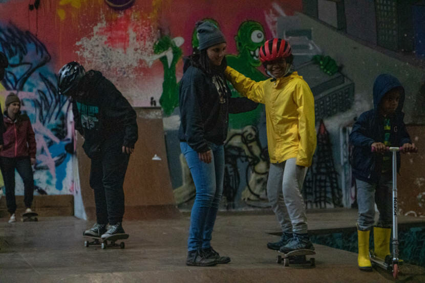 Kids from the Zach Gordon Youth Center learn how to skateboard at Juneau's first women and trans skateboarding session