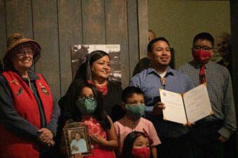 Martin Stepetin stands with his family holding House Bill 10. Alaska Gov. Mike Dunleavey signed the bill on June 8 at the Juneau-Douglas City Museum