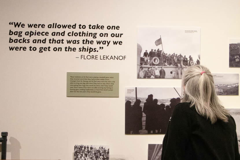 Tara Bourdukofsky looks at the current exhibit on display at the Juneau-Douglas City Museum about Unangax̂ internment during World War II.