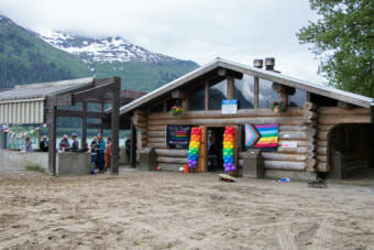 People gather around a shelter at Sandy Beach for a Pride picnic on May 11. The picnic is an annual event that Juneau's LGBTQ+ alliance group SEAGLA sponsors.