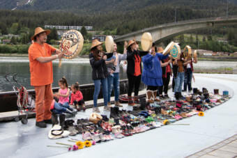 Drummers sing songs to honor the children found buried at a residential school in Kamloops, British Columbia. (Photo by Lyndsey Brollini/KTOO)