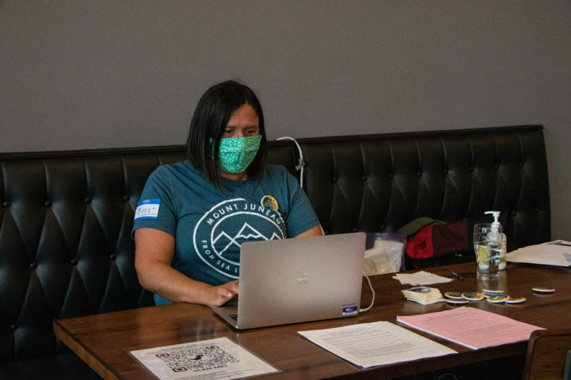 Tracy Balovich helps with the administration side of the COVID-19 vaccine clinic at Forbidden Peak Brewery