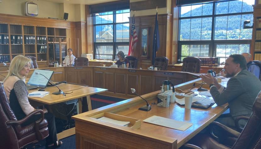 Lucinda Mahoney, commissioner of the Alaska Department of Revenue, left, listens to Rep. Ben Carpenter, R-Nikiski, right, during the House Finance Committee meeting on June 8, 2021, in the Alaska State Capitol in Juneau. (Photo by Andrew Kitchenman/KTOO and Alaska Public Media)