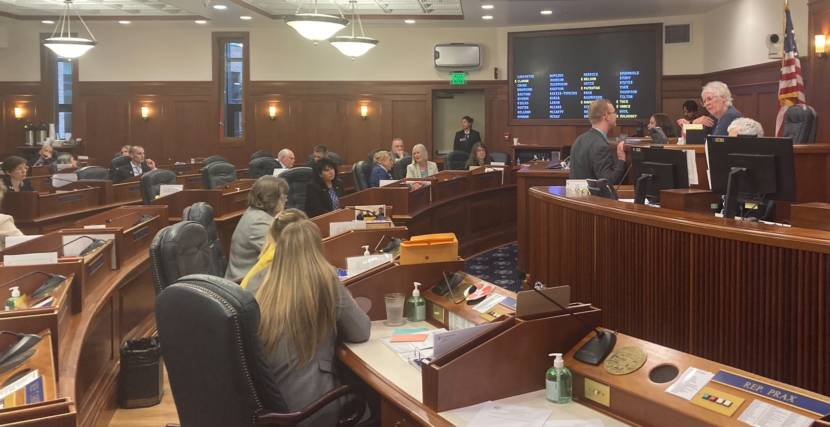 Alaska House of Representative members attend the first floor session of the second special session this year on June 23, 2021, in the Alaska State Capitol in Juneau. House Speaker Louise Stutes, R-Kodiak, on the far right, talks with Rep. David Eastman, R-Wasilla, about comments he was making on the floor. (Photo by Andrew Kitchenman/KTOO and Alaska Public Media)