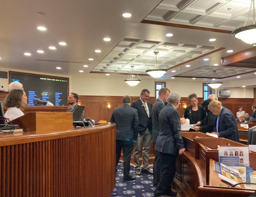 Members of the Republican House minority caucus confer during a break in the floor session on June 29, 2021, in the Alaska State Capitol in Juneau. The House voted to avert a state government shutown, but communication broke down during part of the day, delaying the vote. (Photo by Andrew Kitchenman/KTOO and Alaska Public Media)