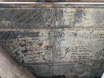 """Many of those who reached the bus left messages addressed to McCandless and their fellow """"pilgrims."""" (Photo courtesy Tim Ellis/KUAC)"""