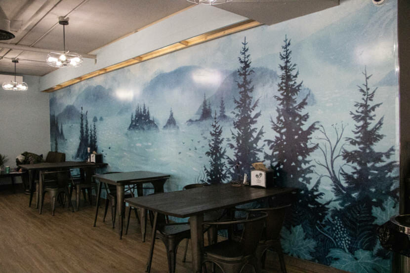 Mural created by Tlingit artist Michaela Goade on the wall of the coffee shop Sacred Grounds in Juneau, Alaska. (Photo by Lyndsey Brollini/KTOO)