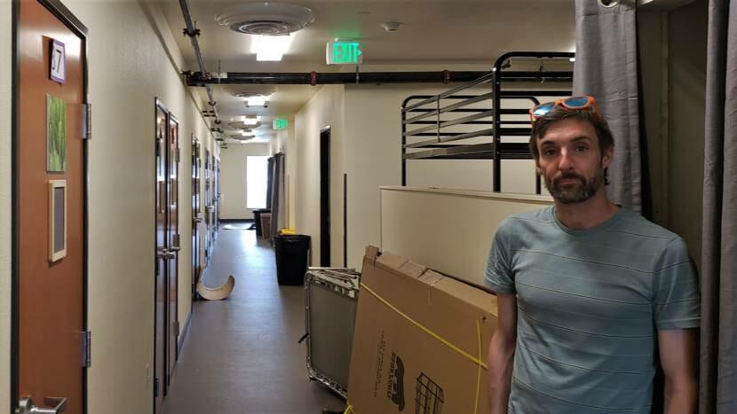 Luke Vroman in dormitory area of new Glory Hall