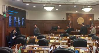 Members of the Alaska House Republican minority caucus leave the floor to discuss the wording of an agreement with the mostly Democratic majority to prevent a shutdown of much of state government on June 28, 2021, in the Alaska State Capitol in Juneau. House minority caucus members' votes have been at the center of debates on how and at what level to fund permanent fund dividends and other programs. (Photo by Andrew Kitchenman/KTOO and Alaska Public Media)