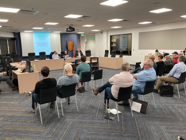 Members of the Alaska legislative comprehensive fiscal plan working group meet on July 22, 2021, in the Anchorage Legislative Information Office. The group announced four days of public testimony starting on July 29. (Photo by Andrew Kitchenman/KTOO and Alaska Public Media)