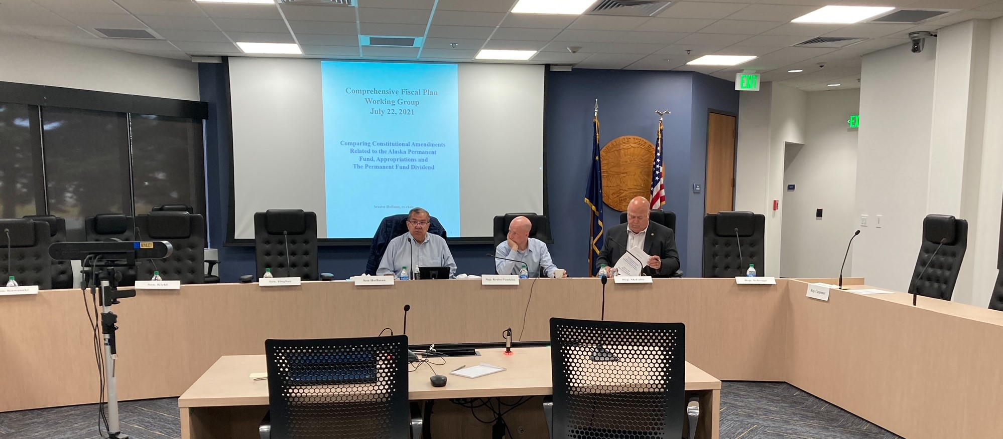 Sen. Lyman Hoffman, D-Bethel; Rep. Jonathan Kreiss-Tomkins, D-Sitka; and Rep. Kevin McCabe, R-Big Lake, attend a comprehensive fiscal plan working group meeting on July 23, 2021, at the Anchorage Legislative Information Office. (Photo by Andrew Kitchenman/KTOO and Alaska Public Media)