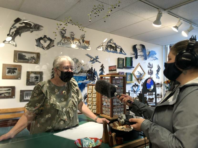 Kaysa Korpela is interviewed about business from cruise ship passengers on July 23, 2021. Korpela is an employee at The Bear's Lair, a gift shop in Juneau.