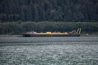 The Columbia Layne sails through the Gastineau Channel after crashing into the Douglas Bridge on Aug. 25, 2021 in Juneau, Alaska. (Photo by Lyndsey Brollini/KTOO)