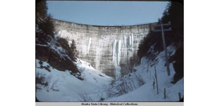 The Salmon Creek Dam, designed by Lars Jorgensen, chief engineer Harry L. Wallenerg, was the first true constant-angle arch dam. It is 168 feet high and 648 feet across. Completed in 1914. Alaska Electric Light and Power Company acquired the Alaska - Juneau Gold Mining Company properties. Photo courtesy Caroline Jensen and the Alaska State Library)