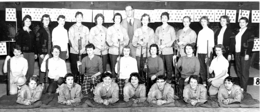 The 1958-'59 high school rifle club poses for a yearbook photo.
