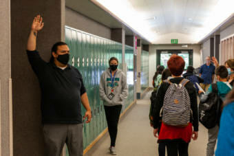 Frank Henry Kaash Katasse guides students to his classroom for a Tlingit class at Dzantik'i Heeni middle school on the first day of school on Monday, August 16, 2021, in Juneau, Alaska. (Photo by Rashah McChesney/KTOO)