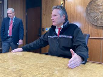 Gov. Mike Dunleavy talks with reporters on Sept. 14, 2021 in the cabinet room in the Alaska State Capitol in Juneau, Alaska. He discussed several issues related to the end of the third special session of the year. He called for a fourth special session later in the day. Dunleavy spokesperson Jeff Turner is on the left. (Photo by Andrew Kitchenman/KTOO and Alaska Public Media)