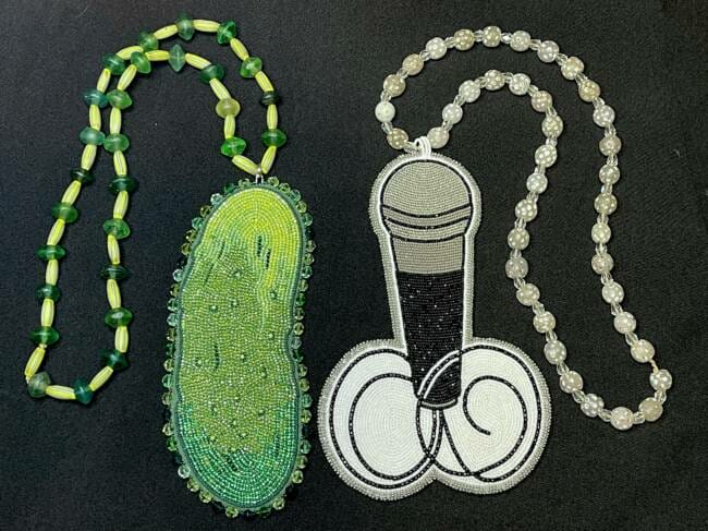 Two beaded medallions, a pickle and a microphone, made by Kaasteen Jill Meserve for the show Reservation Dogs. (Photo courtesy of Jill Meserve)