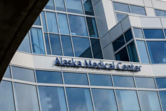 """A sign on the side of a hospital building that says """"Alaska Medical Center"""""""