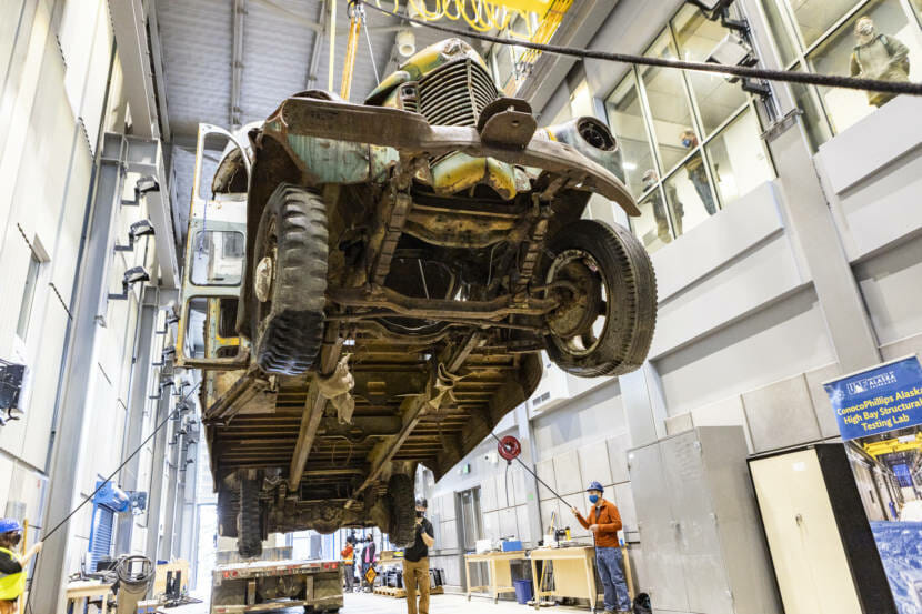 view of the underside of the McCandless bus as it's lowered into place indoors