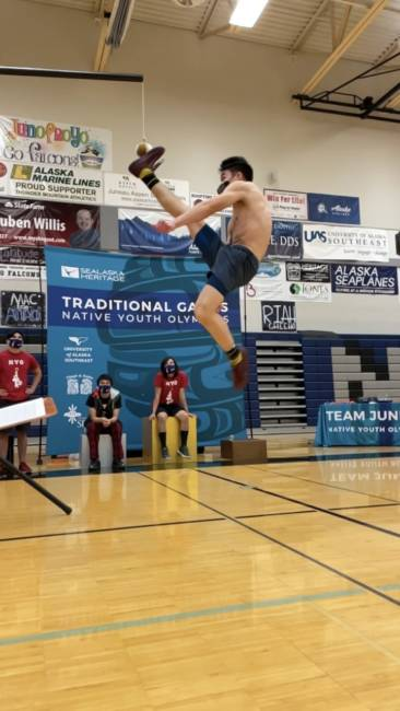 An athlete participates in the One-Foot High Kick during the 2021 Traditional Games in Juneau.